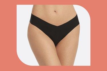 black Spanx underwear statements thong on a white background