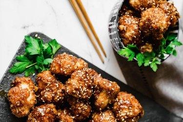 Air-Fryer Veggie BBQ Cauliflower Wings on a black plate with chopsticks