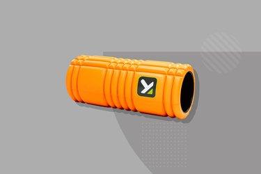 orange triggerpoint grid foam roller on gray background