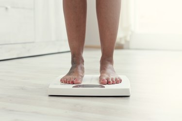 close view of a woman's feet on a bathroom scale