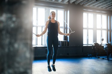 A jumping rope during a HIIT workout, as an example of what to do to lose belly fat in two weeks
