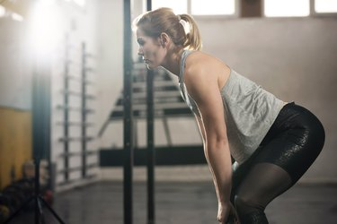 lean woman doing deadlifts in the gym as one of the best exercises for women