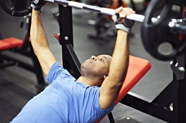 Black Male on Bench Press Doing Barbell Chest Exercises