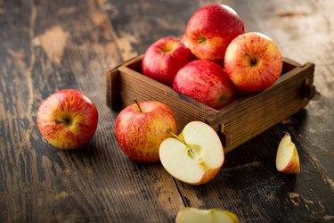 boron-rich apple isolated on wood background