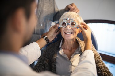 older woman getting an eye exam, as a method of fall prevention