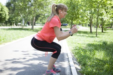 Middle age woman exercising