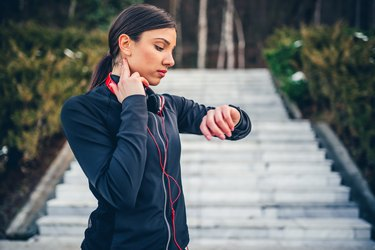 Jogger checking pulse on neck
