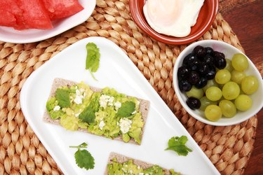 grapes and guacamole on table
