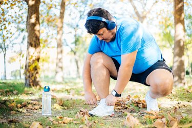 Man tying shoe laces before exercising outdoor