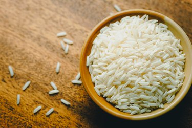 Directly Above Shot Of Rice In Bowl for a rice compress, a natural remedy for earache