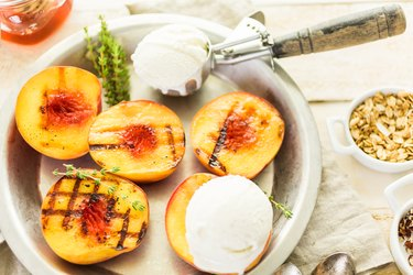 Organic grilled peaches with ice cream on top