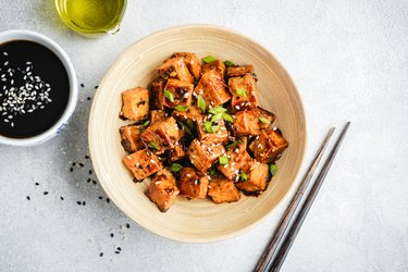 Stir fried marinated tofu topped with sesame, a major food allergen