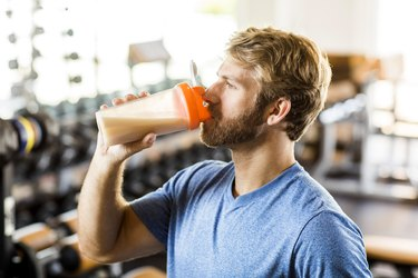 Man drinking protein shake at the gym