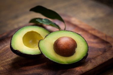 aspartic-rich avocado halves on a wooden board