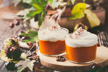 Homemade autumn dessert of sweet potato mousse with whipped cream