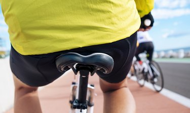 closeup of a man's hips on a bike seat, experiencing tailbone from from cycling