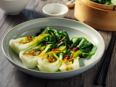 sulforaphane-rich bok choy on plate with drizzle of sauce