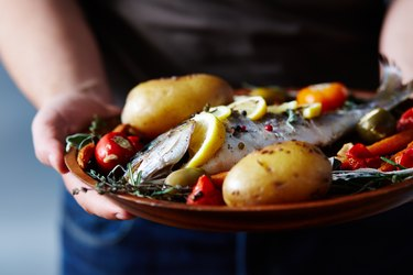 Appetizing Meal With Baked Fish as an example of foods to eat on an eczema diet