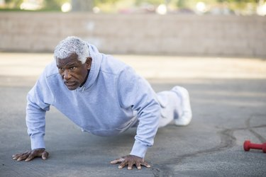 an older man outside doing push-ups, as a natural remedy for enlarged prostate