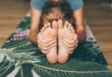 Woman Doing Yoga On A Yoga Mat, as a natural remedy for plantar fasciitis