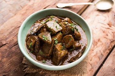 biotin-rich beef liver in bowl on wooden table