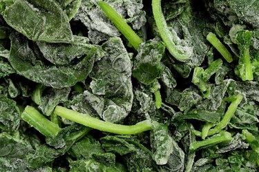 Unthawed block of frozen spinach.