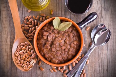 Fiber-rich pinto beans in bowl with spoons