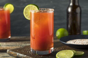 A glass of tomato juice with lime, as an example of foods to avoid with GERD