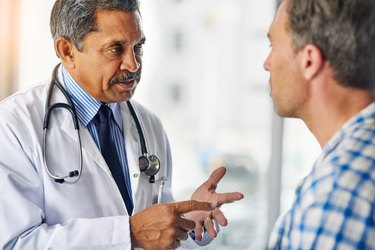 man talking to his doctor about his medications, as a natural remedy for enlarged prostate