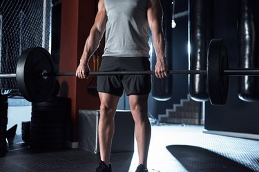 Man performing a deadlift with a pronated grip