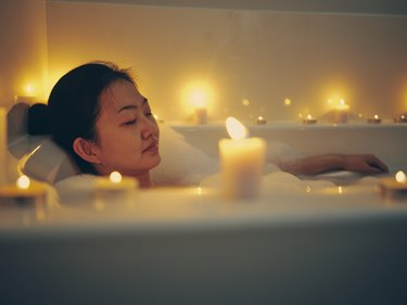 woman Taking a Candlelight Bath as a form of self-soothing