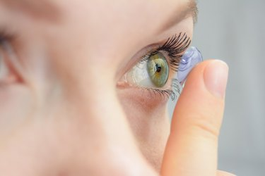 close view of a person putting in contacts