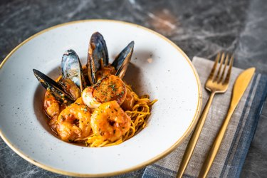 Italian Seafood Pasta with shrimps and clams, aka shellfish, common food allergen,