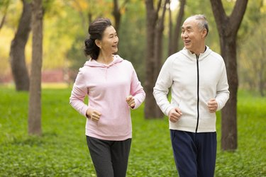 senior chinese couple jogging in the park