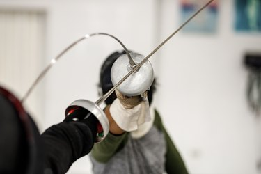 close up of two fencing swords against each other in a match