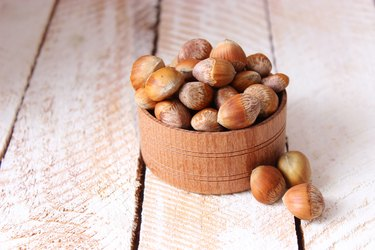 Peeled hazelnuts, a variety of tree nuts, on the table close up