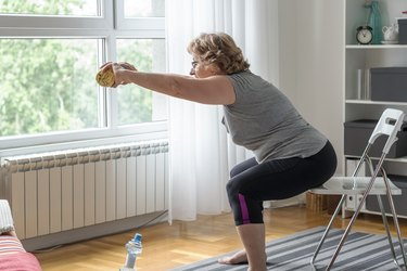 senior women doing the sit-to-stand exercise as one of the best seated exercises for older adults
