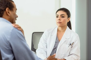 Patient talks about shoulder pain with doctor