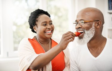 An older couple eating fruit to stay hydrated