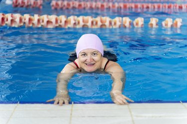 Woman doing swimming exercises to relieve sciatic nerve pain