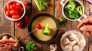 cheese fondue with fresh vegetable- broccoli, tomato, potato and mushroom