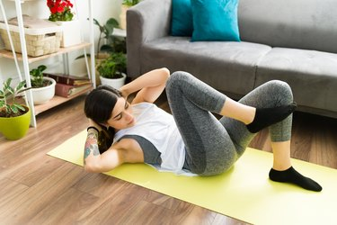 Adult woman training with a high intensity interval workout