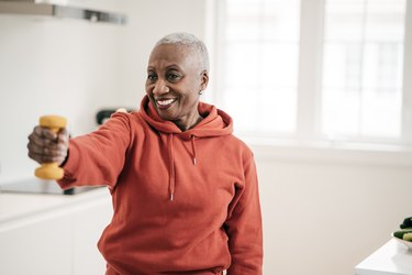 A woman doing exercise after a heart attack at home