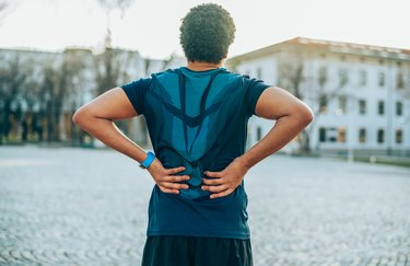 Man with back pain during a workout