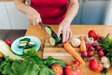 Woman preparing low-fiber vegetables.