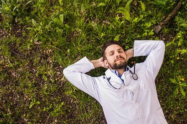 Young doctor meditating in nature for brain health