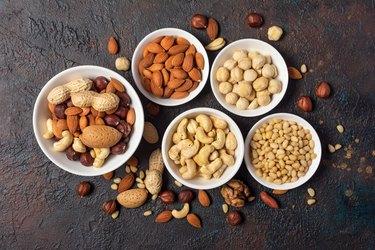 Bowls with almond, hazelnut, walnut, peanut, cashew and pine nuts