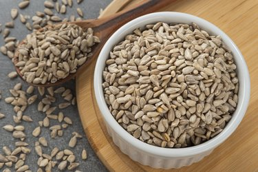 Lectin-rich sunflower seeds in a bowl with a spoon