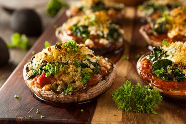 Homemade Baked Stuffed Portobello Mushrooms on wood board