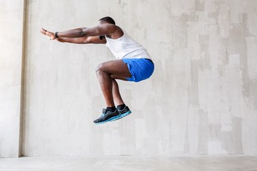 Sporty guy performing his jump upwards
